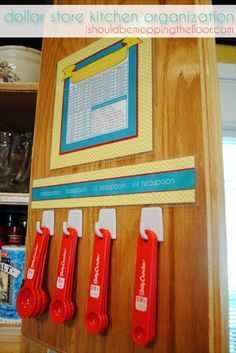 Organize Measuring Spoons Inside the Cabinet Door - 150 Dollar Store Organizing Ideas and Projects for the Entire Home