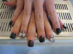 Black cheetah and silver bow nails