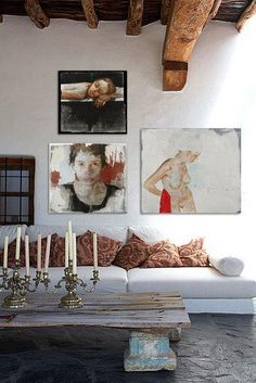 A gallery wall doesn't have to include a gazillion pieces — as proven by this high-impact arrangement of just three beautiful portraits.