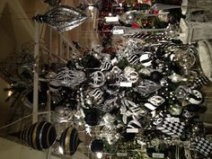 black and white christmas tree with silver and black white baubles connected by black pendant lamps on the ceiling gothic look of black and white christmas