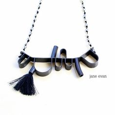 Black 3-D Abstract Beaded Tassel Statement by janeevanmetalwork