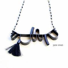 Black 3-D Abstract Beaded Tassel Statement by janeevanmetalwork
