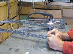 Plasma Pantograph by kenbad -- Homemade plasma pantograph constructed from angle iron, nuts, and bolts. http://www.homemadetools.net/homemade-plasma-pantograph-2