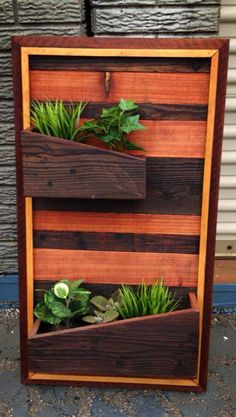 Wall planter from reclaimed wood by Reclamation Republic. http://reclamationrepublic.com
