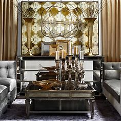 With touches of gold & silver, this living room is simply stunning.