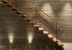 Very simple construction combined with feature wall and good lighting make an excellent stair. Via Feldman Architecture