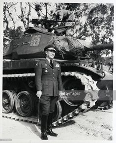 While a Nationalist Chinese soldier works on the turret of a tank behind him, Major General Chiang Wego, 42, head of Nationalist China's Armored Forces, smiles proudly. Wego is the younger son of Nationalist China's President Chiang Kai-Shek. He speaks fluent English, having studied in the United States. He was promoted to his present rank during the Nationalists war against the Chinese Communists