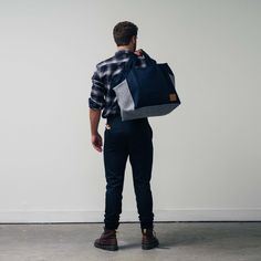 With enviable internal space and unstructured design, The WSw Utility Bag services artisans, bakers and bankers alike with functionality and versatility.    A story of two fabrics, each bag is made using a combination of Japanese selvedge denim and 100% Australian wool with a hand-stitched branded leather patch.