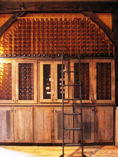 Kessick Wine Racks made from Reclaimed antique barn-wood with rolling library ladder. A library of wine. what could be better? Wine Furniture, Pub Interior, Interior Design, Rolling Ladder, Home Wine Cellars, Wine Cellar Design, Library Ladder, Wine Display, Amazing Spaces