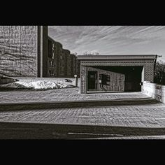 Parking ramp and apartments. #concrete #warmlight #brick #parking #infrastructure #stillwaterminnesota #monochrome