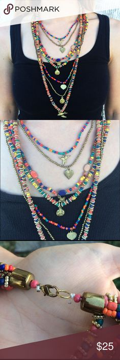 Gorgeous Multicolored Layered Necklace Gorgeous multicolored layered necklace. Made with beads and has little charms. I'm not sure if this is homemade or where it is from but it would be a beautiful statement piece. *Colors may vary slightly from pictures* Unknown Jewelry Necklaces