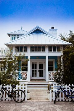 Beach cottage with picket fence. Michael Allen Photography