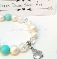 US21.50 Round pearl bracelet Aqua #amazonite beads Pearlescent White #Mountaincrystal Swarovski bicone Penguin charm Winter bracelet Christmas bangle Xmas bracelet Best holiday gift Gift from parents Ideal gift for her Xmas gift idea Round #pearl #winter #bracelet with small penguin charm looks so dainty! This #Christmas bangle could be the best #holiday gifts! It is a great #Xmas gift idea, lovely gift for daughter from parents or ideal #gift for her!