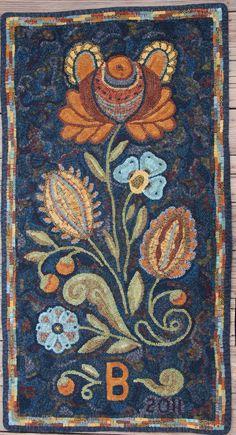 Fraktur Flower rug; designed by Wendy Miller, hooked by Karen Buchheit