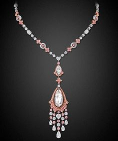Graff diamond necklace featuring 388 pink and white diamonds and a 30.94ct very light pink briolette diamond that has been weightlessly suspended within a rose gold frame and accentuated with a cascade of white and pink diamonds.