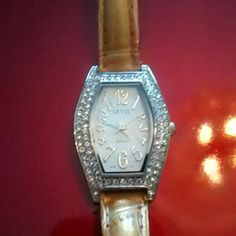 Sevil Quartz Watch Adorable Rhinestone Face Devil Watch. Works perfect! Just bought new battery 2/1/16. Bronze colored strap shows some where but honestly I would just buy a nice black leather strap in its place to really make this beauty pop!! Sevil Jewelry Bracelets