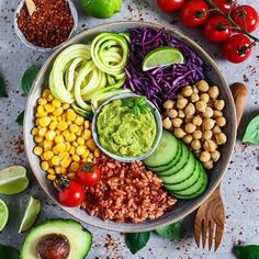 WEBSTA @ veganbowls - Buddha Bowl full of colour from @fitness_bianca It has tomato rice, chickpeas, guacamole, corn, red cabbage, zoodles, cucumber and tomatoes   How yummmyyyy! #veganbowl #buddhabowl  #plantpowered #vegansofig #veganfoodshare #plantbased #healthy #veganfoodshare #whatveganseat #veganfood #crueltyfree #eatclean #cleaneating #healthyfood