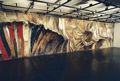 Huge painterly wood installations by Henrique Oliveira. All the wood is salvaged off the streets of São paulo.