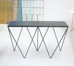 Image of Limited Edition Giraffe console table with deep green leather top