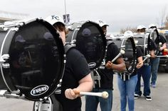 The Olathe North Drumline performs in the Kauffman Stadium parking lot before the game Monday, April 6, 2015, at the Kansas City Royals season opening game with the Chicago White Sox at Kauffman Stadium.