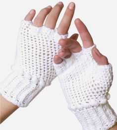 Crocheted Fingerless Gloves.. my daughter needs a pair if these.
