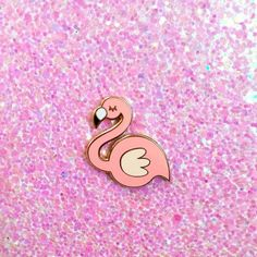 "Flamingo hard enamel lapel pin. Smooth hard enamel with gold trim. Comes with a soft rubber pin back. Pin this to your favorite jacket, bag, sweater, etc Measures 1"" tall"