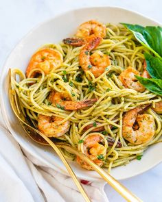 Shrimp pesto pasta is an impressively fast and easy dinner recipe! Cover the noodles in glistening green basil pesto for a meal that pleases everyone. | healthy dinner recipes | shrimp recipes | basil pesto recipes meals | quick and easy pasta recipes | #shrimp #shrimppesto #pestoshrimp #shrimpestopasta #pestopasta #pestorecipe #easydinner #fastdinner #healthydinner #dinneridea Pesto Pasta Recipes, Shrimp Recipes Easy, Pesto Recipe, Seafood Recipes, Healthy Dinner Recipes, Pesto Shrimp Pasta, Seafood Pasta, Quick Recipes, Summer Recipes