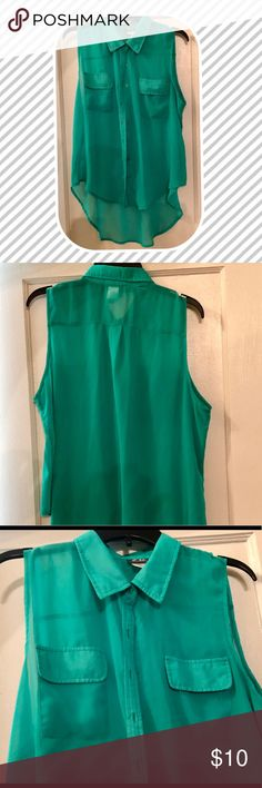 TEAL HI-LOW SLEEVELESS BUTTON DOWN SHIRT  DOTS TEAL SHEER HIGH-LOW SLEEVELESS BUTTON DOWN SHIRT  XL Collar, pockets on the breast area Buttons in front Sheer material  Worn a twice, great condition Dots Tops Button Down Shirts