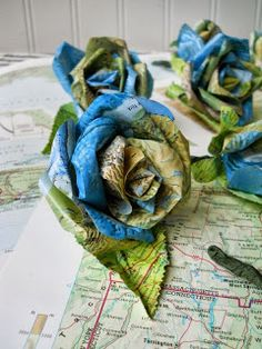 Hi guys! This was a project I was working on this week.. a custom wedding order.  These are boutonnieres made from vintage map p...