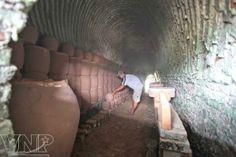 """Dai Hung Pottery, Vietnam wood-fired kiln.  The kiln was built by a Chinese man who settled in the hamlet in the 17th -18th centuries. Note the """"Nubian"""" arch forming technique used in this extensive kiln."""