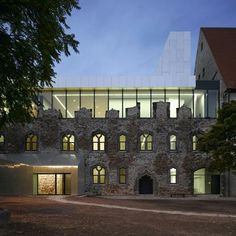 "Architecture: Moritzburg Museum Extension  by Nieto Sobejano Arquitectos: ""..an extension to a museum inside a ruined castle..The architects inserted the extension above the 15th century stonework of the Moritzburg Museum."