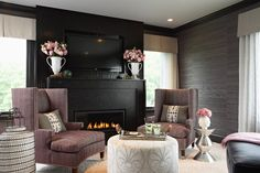 Lucy Interior Design, Minneapolis. - All black fireplace makes the TV disappear.