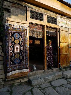 Old carpet seller in Lahic, Azerbaijan