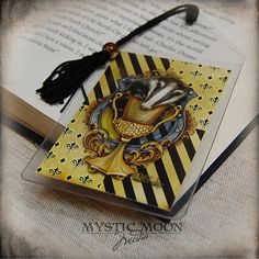 I proudly present Loyalty from my 9 Fandom Art Collection. ~~~~~~~~~~~~~~~~~~~~~~~~~~~~~~~~~~~~~~~~~~~~~~~~~~~~~~~~~~ About the Short Bookmark: Harry Potter Ornaments, Fandom Jewelry, Hufflepuff Pride, Nerd Gifts, Sorting Hat, Collector Cards, Hogwarts Houses, Harry Potter Hogwarts, Pop Culture