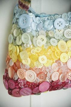 Cute purse.  You could buy a fabric purse and sew the buttons on it.