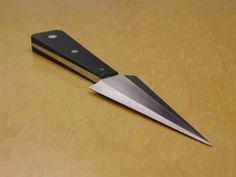 2nd knife by Mark Behnke, Apprentice Smith. 1084 forged and filed, black paper micarta, 304 ss pins