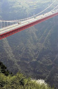 Aizhai suspension bridge in Xiangxi Tujia and Miao, China. Autonomous Prefecture, with a main span of meters and a maximum height of 330 meters, was open to traffic on Saturday. Spanning over the Dehang canyon, the bridge was built as part of the ex Changsha, Grande Route, Scary Bridges, Love Bridge, Beam Bridge, Vietnam Voyage, Bridge Design, Suspension Bridge, Covered Bridges