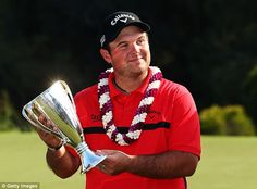 Patrick Reed poses with the winner's trophy after the final round of the Hyundai Tournament of Champions