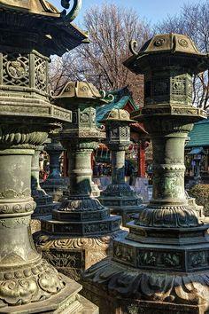 Lanterns on the grounds of Ueno Toshogu Shrine in Ueno Park, Tokyo, Japan.