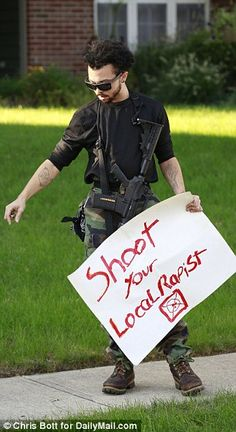 One armed man carried a menacing sign reading 'Shoot your local rapist'