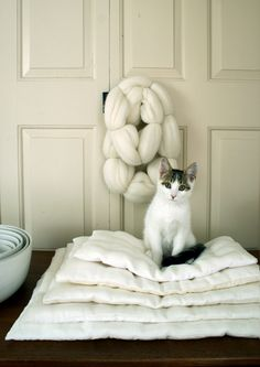 Linen Stacking Pillows (instructions) - This version of these pillows is inspired by rustic yet elegant Japanese interior design. Thin and flat, they are finished with simple tufting, almost like a luxurious feather duvet. They make perfect seat cushions, bed toppers, or couch accents. I also love the way these pillows look in graduating sizes stacked one on top of another.