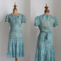 """{ Sold } 1930s cotton dress in a floral print. I hope someone buys this quick before I change my mind! Dress has very puffy sleeves and lace trim over the front with a velvet ribbon. Dress closes with buttons in the back and side opening. It has a self-tie belt at the waist and a flared skirt. Excellent condition, missing one button at the back. Size XS. Bust 17"""", waist 12""""-13 1/2"""", hips 17 1/2"""", shoulders 12.6"""". Length from shoulder 41"""". Dm to purchase!"""