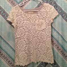 Lacy cream and gray Hollister top! Cute for spring and summer! The front of the top is see through lace so would be cute with a bandeau or a tank under neath! Hollister Tops Tees - Short Sleeve