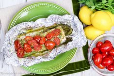 Healthy salmon baked in foil with asparagus and tomato. Only 6 ingredients!