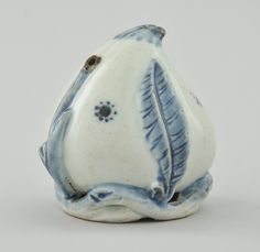 "A Choson Period Water Dropper Porcelain peach in blue and white glazes, resting on open wove base. Apprx 3-1/4""T x 3""D."