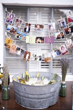 Simple and adorable wedding decorations.  Hang photos of the couple with clothespins and use mason jars to hold preserved and dried flowers.  Pinned by Afloral.com from hwtm.com ~Find supplies you need to DIY your wedding at Afloral.com