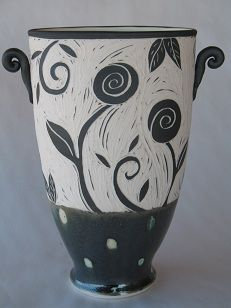 Sgraffito Pottery: The following work is formed by hand, on the potters wheel or by sculpting, using porcelain or stoneware. The clay body has a very smooth texture, which is ideal, as it acts like a canvas for surface decoration. The pots are painted with under glazes and slips, then carved using the sgraffito method, an ancient and time consuming technique of scratching a design through the surface. After the decoration is complete, the pots are bisque fired, glazed and fired again.