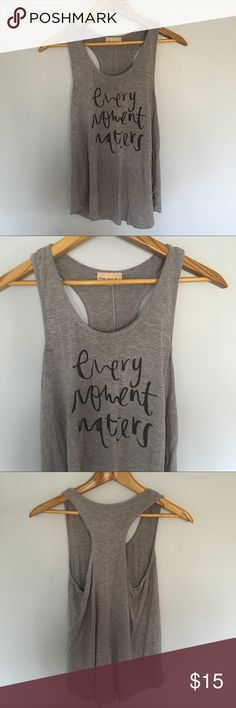 """""""Every Moment Matters"""" Graphic Racerback Tank Top Previously well loved tank top. Cozy and comfy! Perfect in its own or layered. enough about me... Tops Tank Tops"""