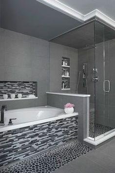 Ideal bathtub, shower configuration, including insets for storage. Different materials - no glass tiles but grey tones are great. Double shower heads in shower and shower faucet for the bathtub is ideal.