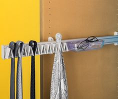 The Ambos range includes options for keeping accessories like ties, belts and scarves neat and tidy. These are available in a fixed option that simply screws to your wall, or in a pull out option (shown here) that extends for easy access and also includes a small tray ideal for holding change, keys, glasses etc.